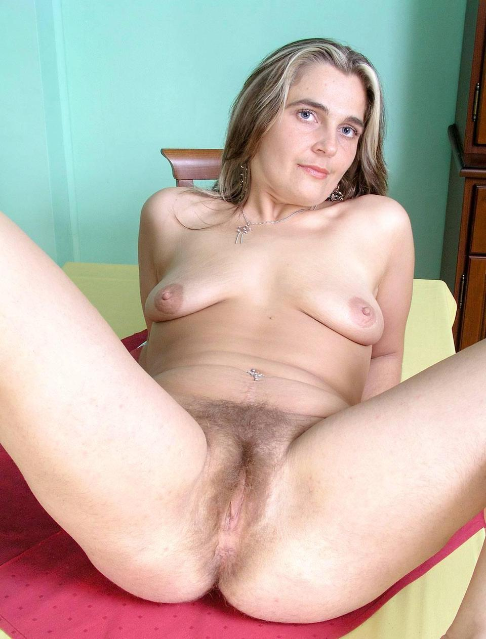 Mature in stockngs and a glass dildo