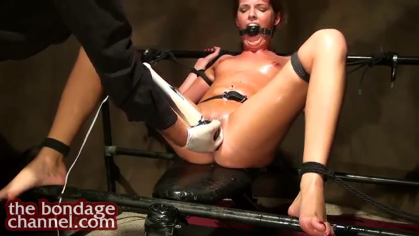 Slut hanging by meat hooks