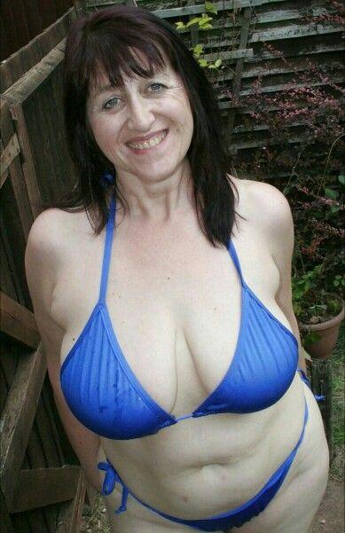 Hot naked blonde mature justine posing